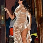 kim-kardashian-sizzles-as-she-shows-off-signature-curves-in-tight-orange-swimsuit-2
