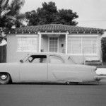 grayscale-coupe-parked-on-roadside
