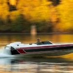 person-driving-black-and-gray-speed-boat-during-daytime